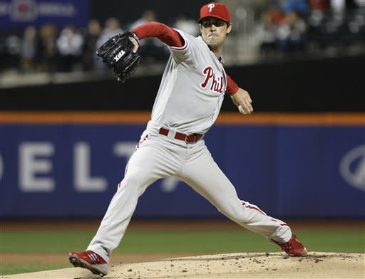 Philadelphia Phillies' Cole Hamels delivers a pitch during the first inning of a baseball game against the New York Mets, Wednesday, Sept. 19, 2012, in New York. (AP Photo/Frank Franklin II)