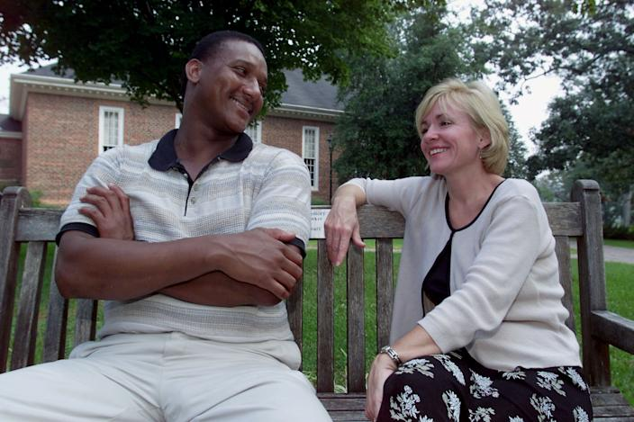 Jennifer Thompson-Cannino, right, with Ronald Cotton in Greensboro, N.C., Sept. 14, 2000. Thompson identified Cotton as the man who raped her in 1984. After serving almost 11 years of a life sentence, Cotton was released from prison when DNA testing revealed another man raped Thompson-Cannino. They have become friends since Cotton's release. (AP Photo/Chuck Burton)