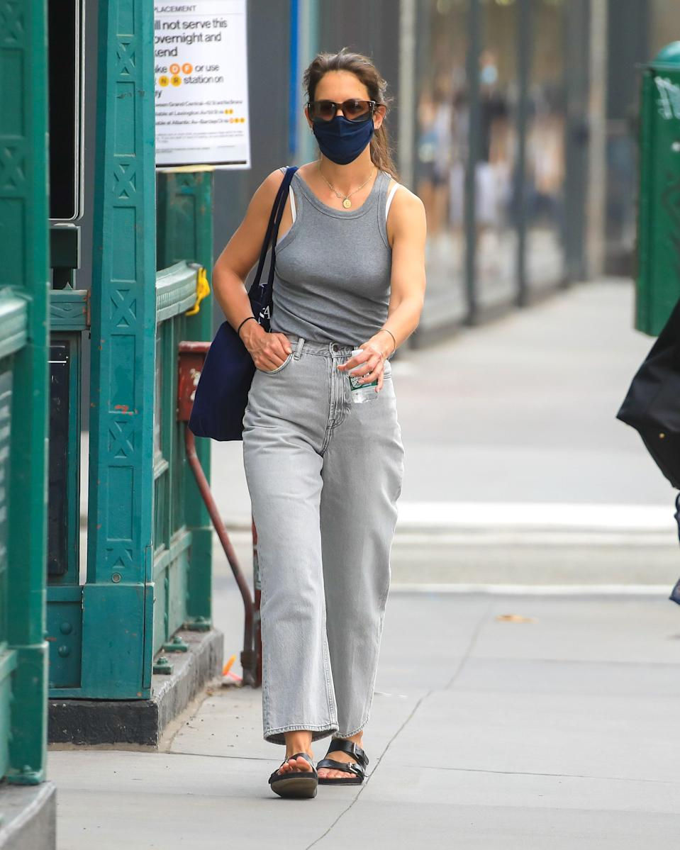 "In case you needed further proof that celebs are just like us, <a href=""https://www.glamour.com/about/katie-holmes?mbid=synd_yahoo_rss"" rel=""nofollow noopener"" target=""_blank"" data-ylk=""slk:Katie Holmes"" class=""link rapid-noclick-resp"">Katie Holmes</a> has been spotted in this For Days face mask <em>for days.</em> (Sorry, couldn't resist.) The brand's face masks are reusable and made from a double layer of organic cotton jersey. They have elastic earloops, and there's also a small pocket to add a protective filter."