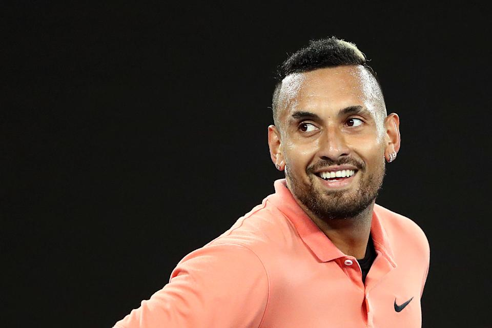 Nick Kyrgios smiles during the 2020 Australian Open.