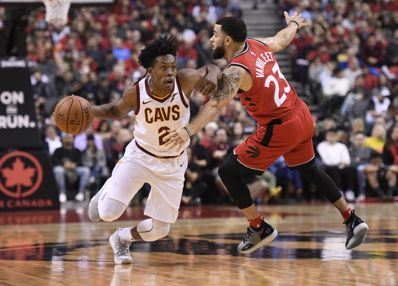 Cleveland Cavaliers guard Collin Sexton (2) drives towards the basket as Toronto Raptors guard Fred VanVleet (23)defends during second half NBA basketball action in Toronto on Wednesday, Oct. 17, 2018. (Nathan Denette/The Canadian Press via AP)