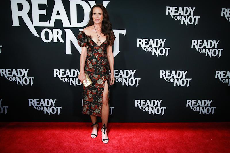 Andie MacDowell wore a Markarian puff-sleeved dress with a black, green and red print on it. [Photo: Getty]