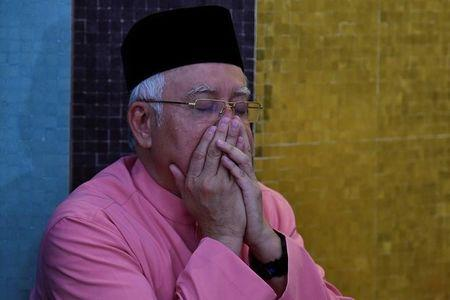 Malaysia's former Prime Minister Najib Razak prays before he attends the United Malays National Organisation (UMNO) 72th anniversary celebrations in Kuala Lumpur, Malaysia May 11, 2018. REUTERS/Stringer