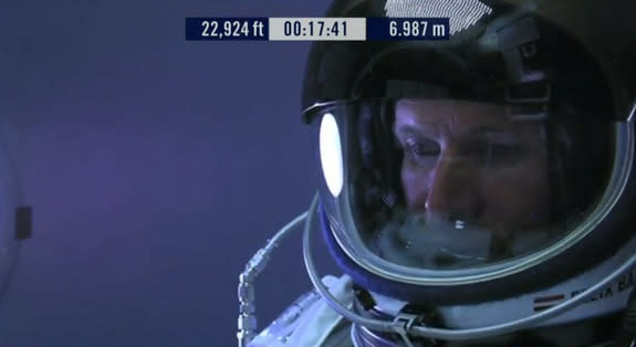 Felix Baumgartner is shown inside his capsule as he ascends in preparation for his record-breaking jump Oct 14, 2012.