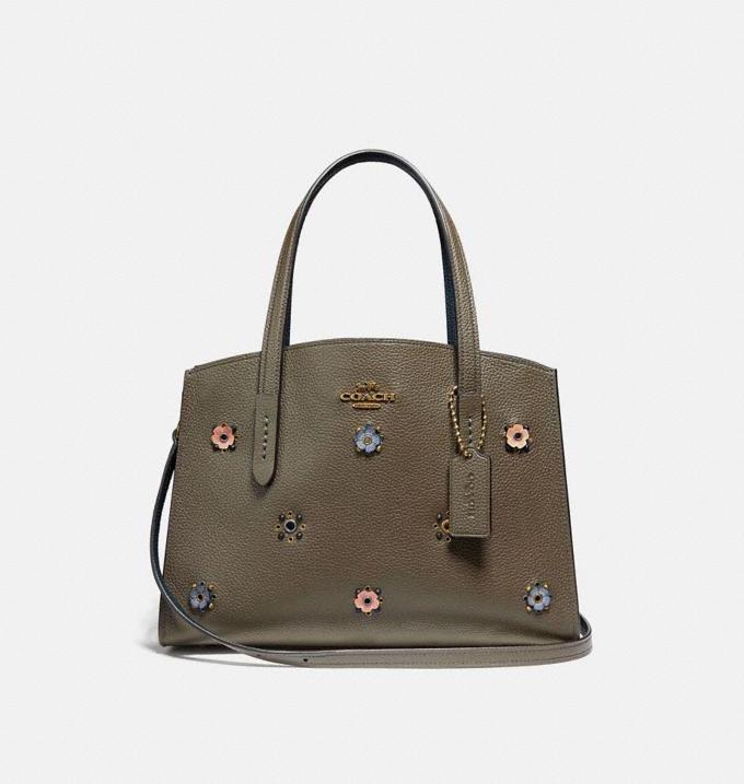 Charlie Carryall 28 With Scattered Rivets. Image via Coach.