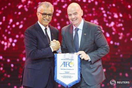 Asian Football Confederation (AFC) President Shaikh Salman Ebrahim Al Khalifa and FIFA President Gianni Infantino pose during the AFC Annual Awards 2017 at the Aksra Theatre King Power in Bangkok