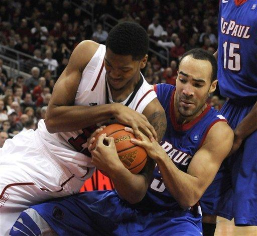 Louisville's Zach Price, left, battles DePaul's Krys Faber for a loose ball during the first half of their NCAA college basketball game Saturday, Jan. 14, 2012 in Louisville, Ky. (AP Photo/Timothy D. Easley)
