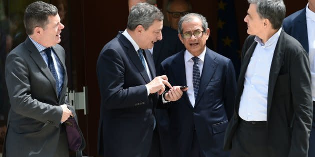 Ireland's Public Expenditure and Reform Minister Paschal Donohoe talks with Greek Finance Minister Euclid Tsakalotos, President of the European Central Bank, Mario Draghi, Italian Minister of Economy and Finance Giovanni Tria