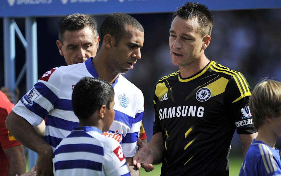 Queens Park Rangers' English defender Anton Ferdinand (L) avoids shaking hands with Chelsea's English defender John Terry (R) - AFP