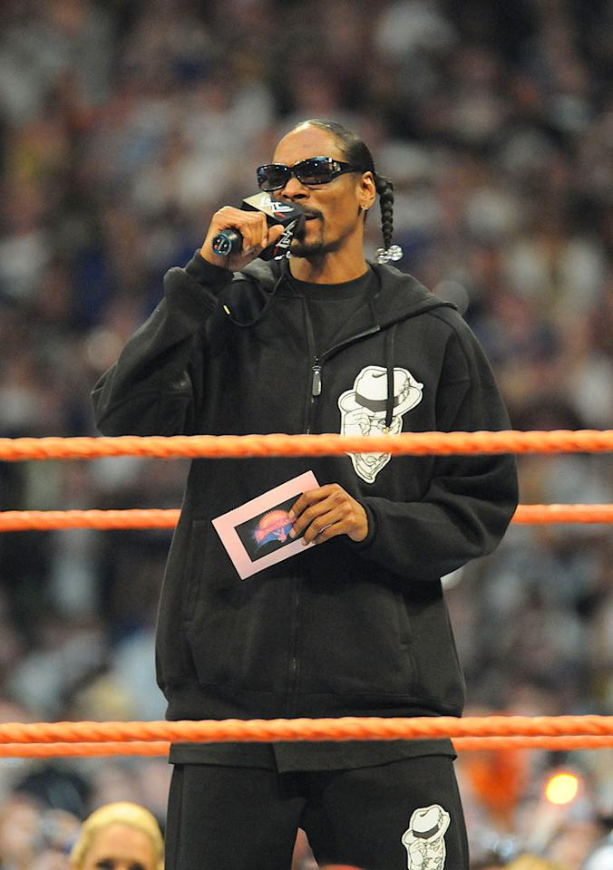 """Self-proclaimed pro wrestling fan Snoop Dogg takes part in the festivities by presiding over the BunnyMania Lumberjack Match, featuring the dazzling WWE divas. George Napolitano/<a href=""""http://www.filmmagic.com/"""" target=""""new"""">FilmMagic.com</a> - March 30, 2008"""