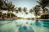 """Right on Xpu-ha Beach, the best stretch of white sands on this part of <a href=""""https://www.cntraveler.com/gallery/mexico-eastern-top-resorts?mbid=synd_yahoo_rss"""" rel=""""nofollow noopener"""" target=""""_blank"""" data-ylk=""""slk:Mexico's Caribbean coast"""" class=""""link rapid-noclick-resp"""">Mexico's Caribbean coast</a>, Esencia is one of those hotels that is spoken about in hushed tones by bohemians in the know, none of whom want to let this secret get out. But those who do make it here discover a small, natural beauty of place set on a palm-swaying estate on the edge of the tumbling sea. There are hammocks to laze in, and a dimly lit spa where bespoke blends—made from ingredients harvested from the waters of the Caribbean and the surrounding Mayan jungle—are crushed into poultices to help smooth out knots. For snorkeling among rainbow-colored fish, the Mesoamerican Barrier Reef is a five-minute hop on the hotel's catamaran. Hungry? There are ceviches and tacos to try at Mistura, a restaurant with views of the moon-dappled sea, and a wooden beach bar housed under a two-story palapa that does the best margaritas in Mexico. And then, of course, there are the rooms: the interiors of the house, originally built as a hideaway for an Italian duchess, have splashes of 1950s art and huge bedrooms with generous terraces; Jungle Suites with plunge pools (some indoor, some outdoor) and beach suites are a study in white."""