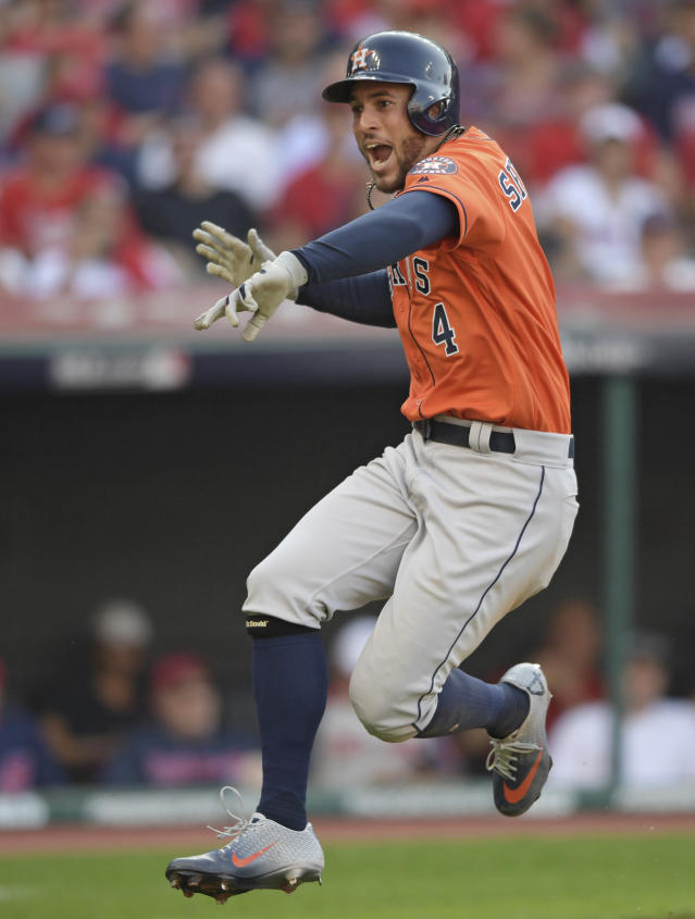 Houston Astros' George Springer celebrates after hitting a solo home run in the eighth inning during Game 3 of a baseball American League Division Series against the Cleveland Indians, Monday, Oct. 8, 2018, in Cleveland. (AP Photo/David Dermer)