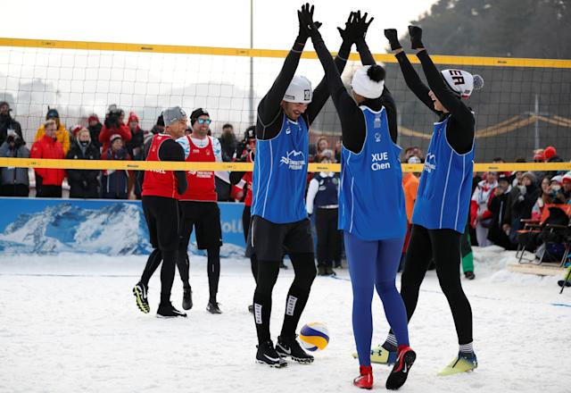 Pyeongchang 2018 Winter Olympics - Pyeongchang - South Korea – February 14, 2018. Players celebrate during an event promoting the Snow Volleyball hosted by the International Volleyball Federation (FIVB) and European Volleyball Confederation (CEV) in Pyeongchang. REUTERS/Kim Hong-Ji