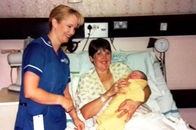 Laura Woffendin, from Pontefract, Yorkshire, with midwife Emma Reevell, 50, at Laura's birth.