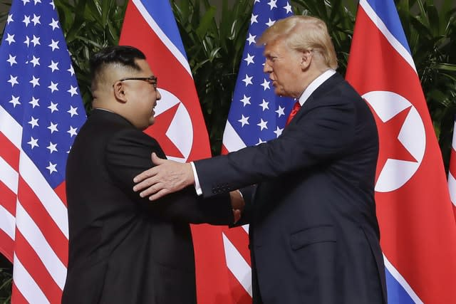 Kim Jong Un meets with Donald Trump in 2018 (Evan Vucci, File/AP)