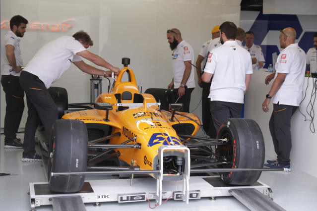 The team of Fernando Alonso, of Spain, works on his car in the garage area during practice for the Indianapolis 500 IndyCar auto race at Indianapolis Motor Speedway, Thursday, May 16, 2019 in Indianapolis. Alonso, heavily damaged his car in a cr yesterday. (AP Photo/Michael Conroy)