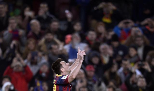 FC Barcelona's Lionel Messi, from Argentina, reacts after scoring against Getafe during a Copa del Rey soccer match at the Camp Nou stadium in Barcelona, Spain, Wednesday, Jan. 8, 2014. (AP Photo/Manu Fernandez)
