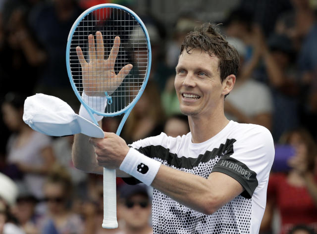 Tomas Berdych of the Czech Republic celebrates after defeating Robin Haase of the Netherlands in their second round match at the Australian Open tennis championships in Melbourne, Australia, Wednesday, Jan. 16, 2019. (AP Photo/Aaron Favila)
