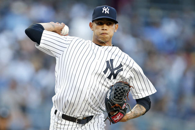 New York Yankees pitcher Jonathan Loaisiga throws to first base to check on a Tampa Bay Rays base runner during the first inning of a baseball game on Friday, June 15, 2018, in New York. Loaisiga was making his major league debut. (AP Photo/Adam Hunger)