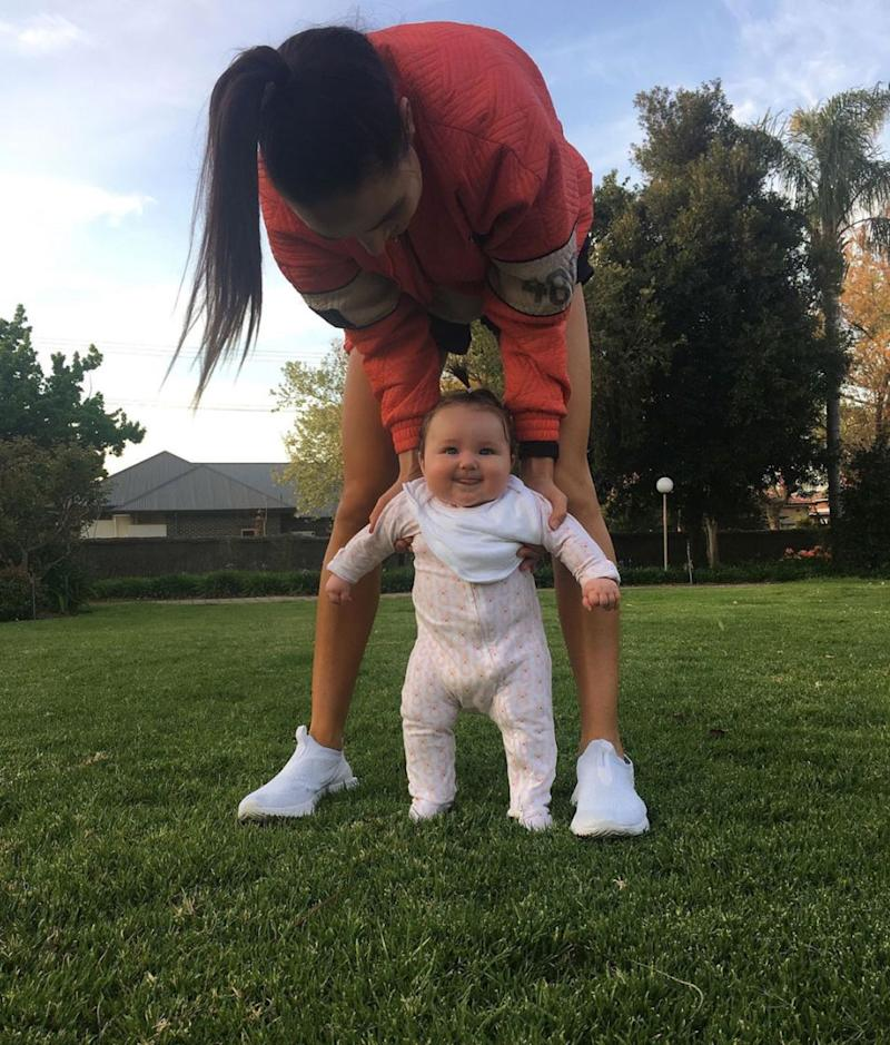 Kayla Itsines with 7-month-old Arna