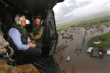 Australian Prime Minister Malcolm Turnbull looks at damaged and flooded areas from aboard an Australian Army helicopter after Cyclone Debbie passed through the area near the town of Bowen, located south of the northern Queensland town of Townsville in Aust