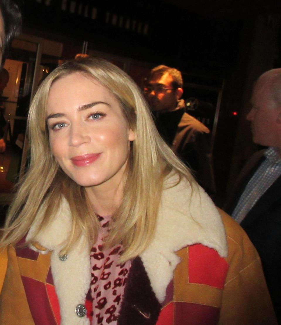 Emily Blunt looks beautiful wearing a brown jacket with furry collar