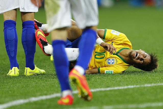 Brazil's Neymar grimaces as he lies on the ground after being fouled by Croatia's Vedran Corluka (unseen) during their 2014 World Cup opening match at the Corinthians arena in Sao Paulo June 12, 2014. REUTERS/Ivan Alvarado (BRAZIL - Tags: SOCCER SPORT WORLD CUP)