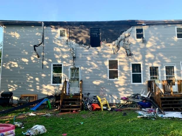 The Amherst fire department says the fire started in a second-floor apartment in the middle of the building and spread to the roof.  (Paul Palmeter/CBC - image credit)