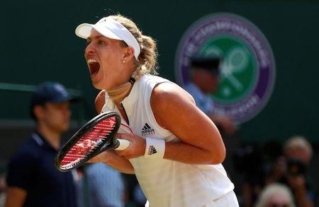 Tennis - Wimbledon - All England Lawn Tennis and Croquet Club, London, Britain - July 12, 2018. Germany's Angelique Kerber celebrates winning her semi final match against Latvia's Jelena Ostapenko. REUTERS/Andrew Couldridge