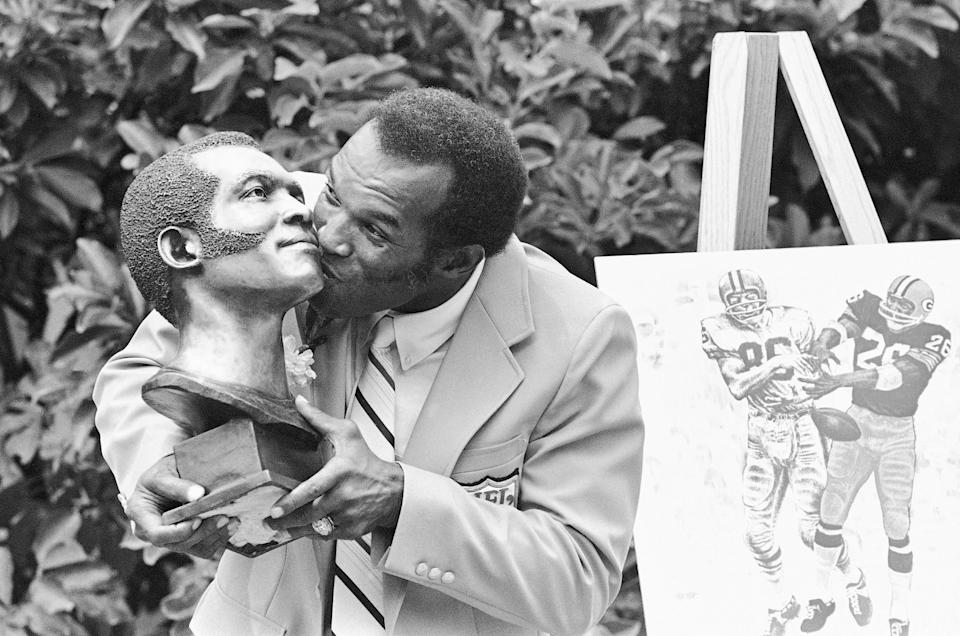 FILE - In this Aug. 2, 1980, file photo, former Green Bay Packers cornerback Herb Adderley hugs his statue after enshrinement in the Pro Football Hall of Fame in Canton, Ohio. Hall of Fame cornerback Herb Adderley has died. He was 81. His death was confirmed Friday, Oct. 30, 2020, on Twitter by nephew Nasir Adderley, a safety for the Los Angeles Chargers. Adderley played on six NFL title teams over a 12-year career with Green Bay and Dallas. (AP Photo/File)