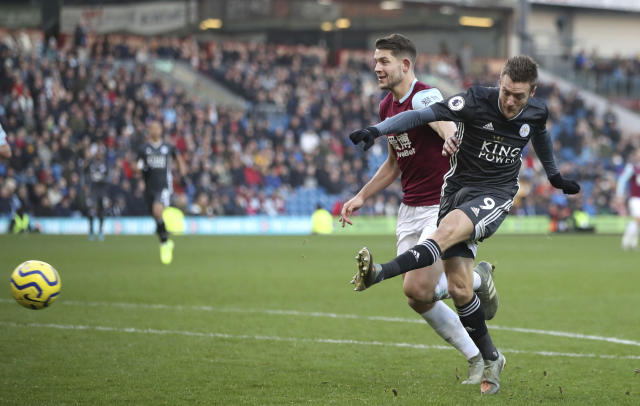 Leicester City's Jamie Vardy, right, has an unsuccessful shot on goal under pressure form Burnley's James Tarkowski, during their English Premier League soccer match at Turf Moor in Burnley, England, Sunday Jan. 19, 2020. (Nick Potts/PA via AP)
