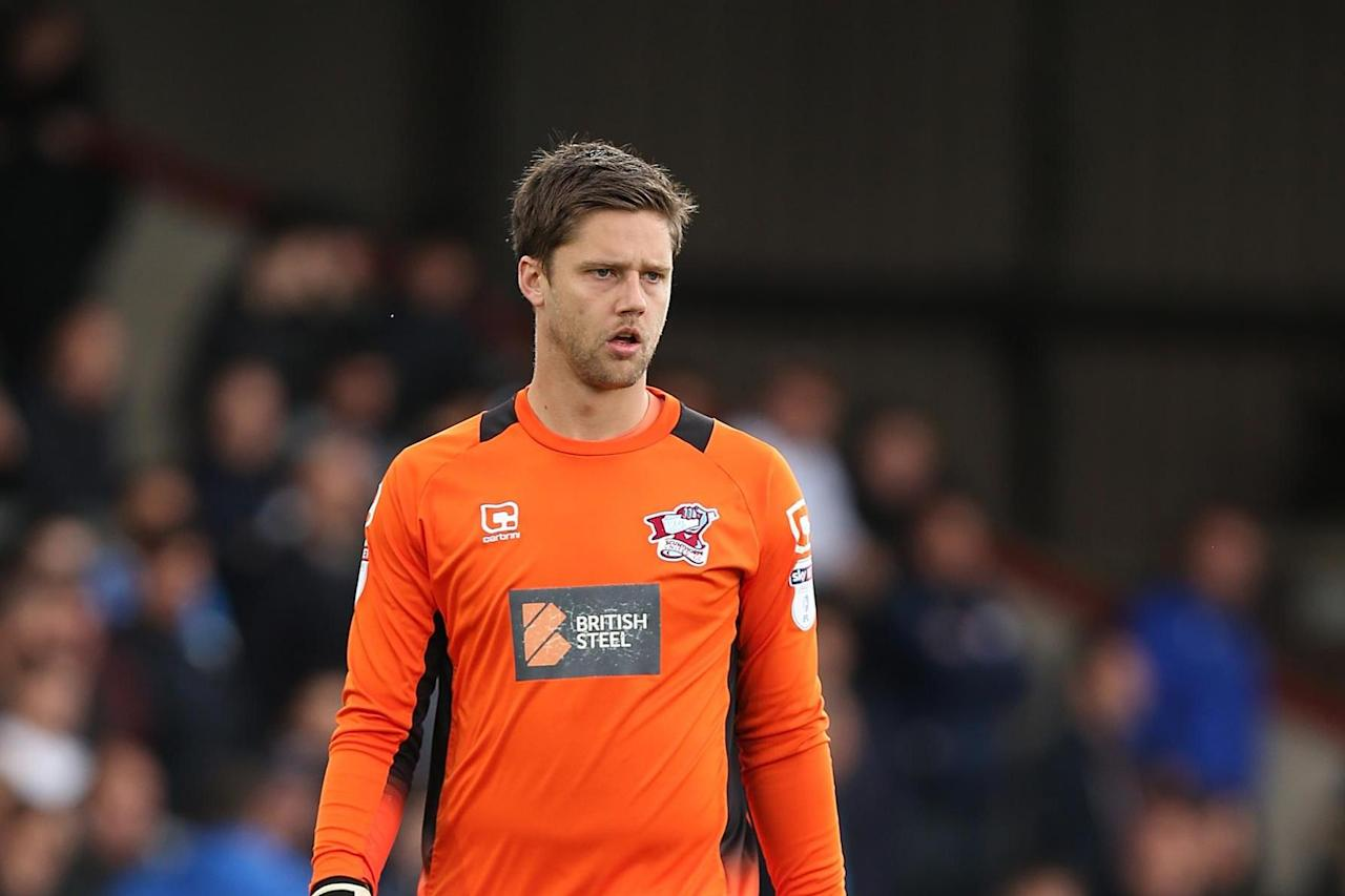 Brentford follow Henrik Dalsgaard signing with free transfer of goalkeeper Luke Daniels from Scunthorpe