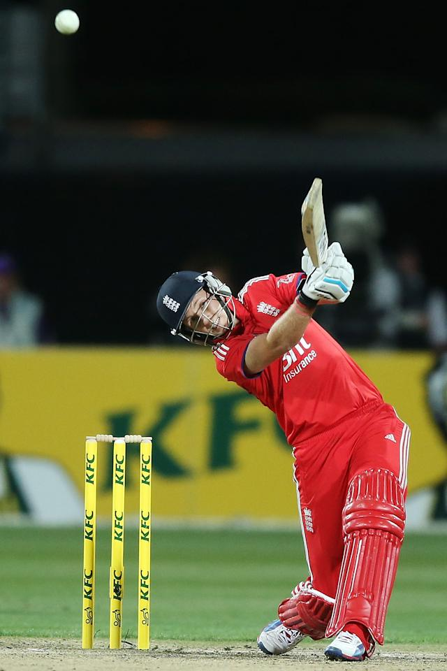 HOBART, AUSTRALIA - JANUARY 29:  Joe Root of England hits a boundary during game one of the International Twenty20 series between Australia and England at Blundstone Arena on January 29, 2014 in Hobart, Australia.  (Photo by Michael Dodge/Getty Images)