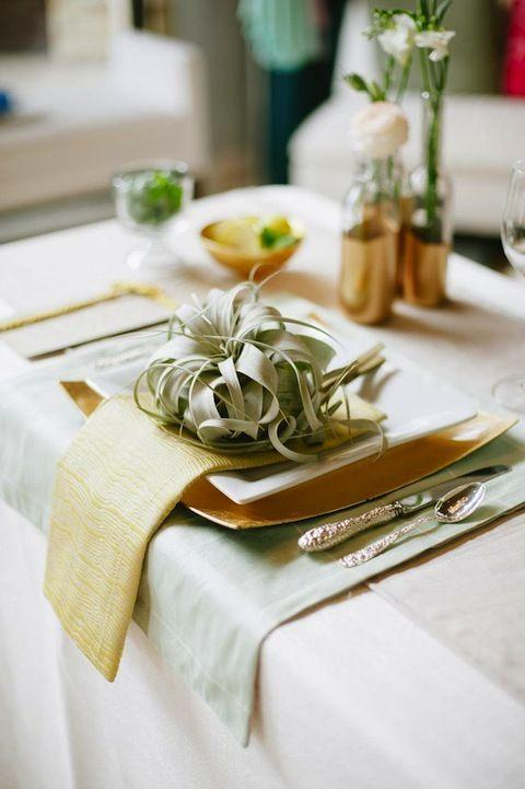 "<p>Mix varying shades of gold and green together for a natural tablescape. The green is grounding, but gold feels celebratory. </p><p>See more at <a href=""https://www.stylemepretty.com/living/2013/06/18/a-design-workshop-from-mayhar-design/"" rel=""nofollow noopener"" target=""_blank"" data-ylk=""slk:Style Me Pretty"" class=""link rapid-noclick-resp"">Style Me Pretty</a>.</p>"