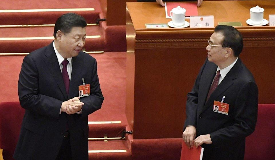 Chinese President Xi Jinping and Premier Li Keqiang exchange words after the closing session of the National People's Congress on Thursday. Photo: Kyodo