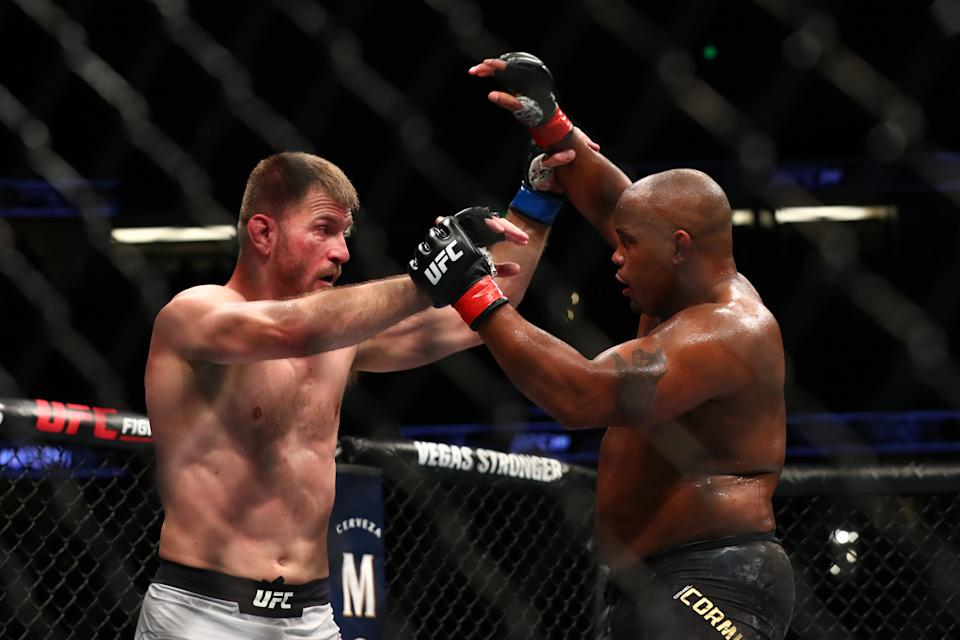 ANAHEIM, CALIFORNIA - AUGUST 17:  Daniel Cormier throws a punch at Stipe Miocic in the second round during their UFC Heavyweight Title Bout at UFC 241 at Honda Center on August 17, 2019 in Anaheim, California. (Photo by Joe Scarnici/Getty Images)