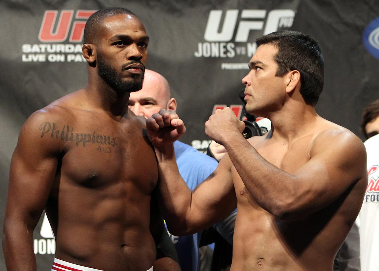 "TORONTO, ON - DECEMBER 09:  (L-R) UFC Light Heavyweight Champion Jon ""Bones"" Jones and challenger Lyoto Machida face off after weighing in during the UFC 140 Official Weigh-in at the Air Canada Centre on December 9, 2011 in Toronto, Canada.  (Photo by Josh Hedges/Zuffa LLC/Zuffa LLC via Getty Images)"