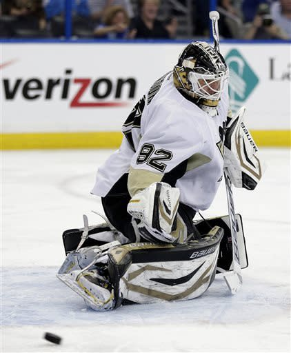 Pittsburgh Penguins goalie Tomas Vokoun (92), of the Czech Republic, makes a save on a shot by the Tampa Bay Lightning during the second period of an NHL hockey game, Thursday, April 11, 2013, in Tampa, Fla. (AP Photo/Chris O'Meara)