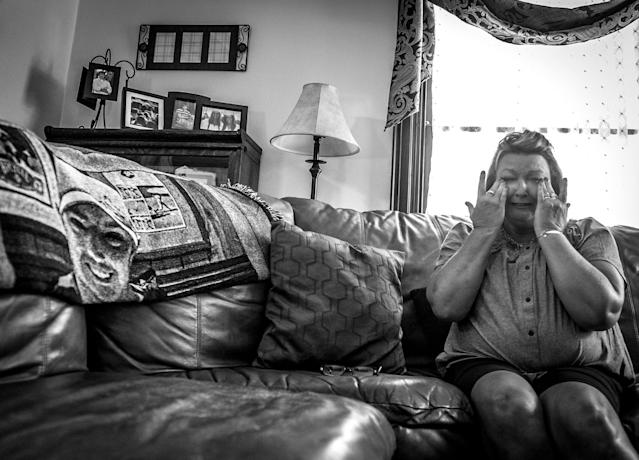 Beth Genslinger tells the story of her son, Andy, who died from a heroin overdose in his bedroom in Germantown, Ohio. He is pictured on a blanket next to her. (Photograph by Mary F. Calvert for Yahoo News)