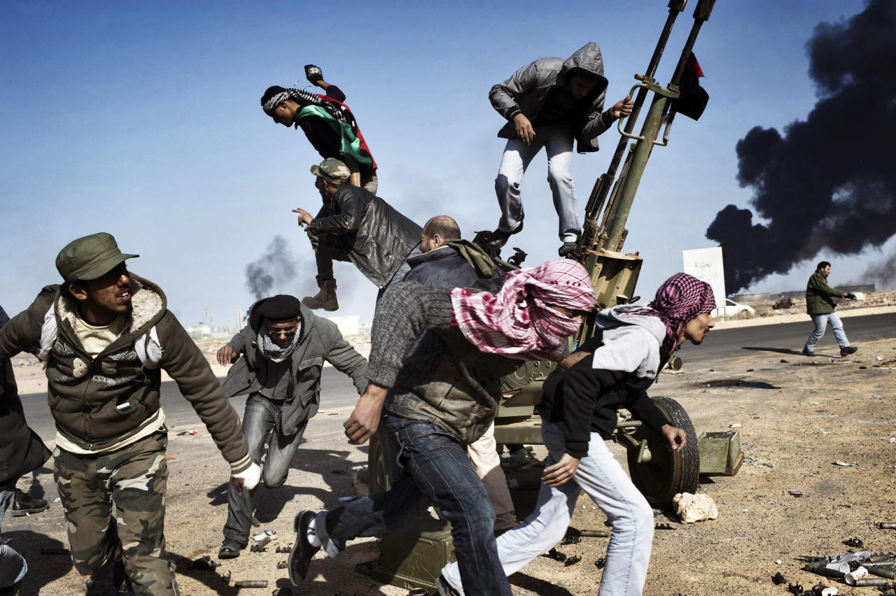 In this photo provided on Friday Feb. 10, 2012 by World Press Photo, the 1st prize Spot News Singles category of the 2012 World Press Photo Contest by Yuri Kozyrev, Russia, Noor Images for Time shows rebels in Ras Lanuf, Libya, March 11, 2011. (AP Photo/Yuri Kozyrev, Noor Images for Time)