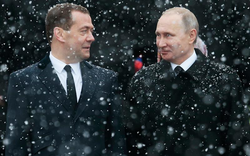 Dmitry Medvedev, left, speaks to Vladimir Putin at a wreath laying ceremony in Moscow on February 23 - Copyright 2017 The Associated Press. All rights reserved.