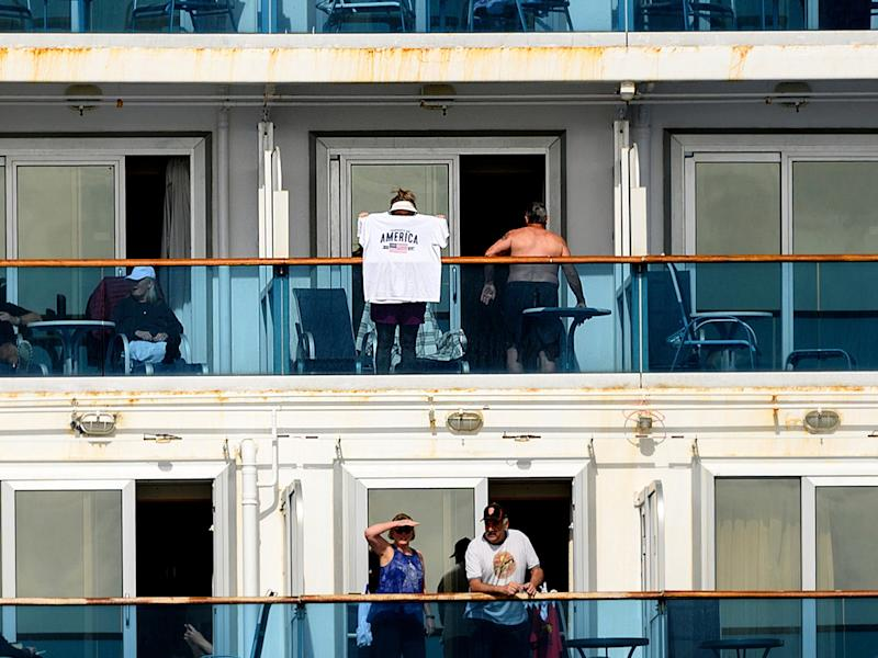 8 Passengers look out from balconies aboard the Grand Princess as it cruises a holding pattern about 25 miles off the coast of San Francisco on Sunday, March 8, 2020.