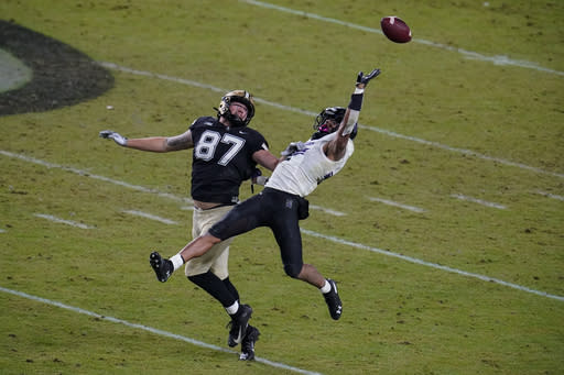 Northwestern defensive back Greg Newsome II, right, breaks up a pass intended for Purdue tight end Payne Durham (87) during the fourth quarter of an NCAA college football game in West Lafayette, Ind., Saturday, Nov. 14, 2020. Northwestern defeated Purdue 27-20. (AP Photo/Michael Conroy)
