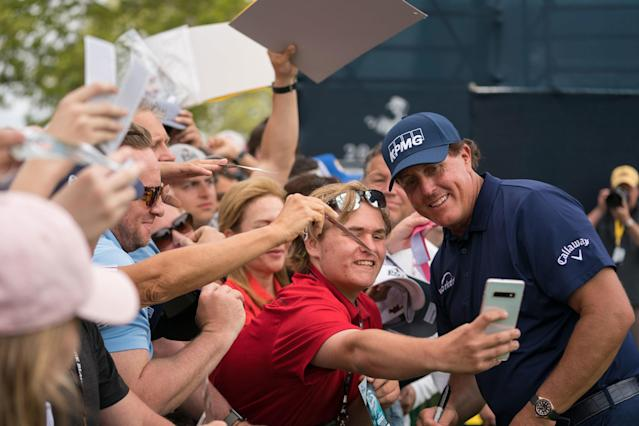 "<div class=""caption""> A spectator takes a selfie with Mickelson at the 2019 PGA Championship. </div> <cite class=""credit"">Montana Pritchard/PGA of America</cite>"