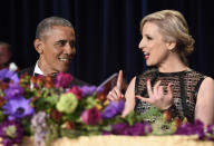 <p>President Obama talks with Carol Lee of the Wall Street Journal at the annual White House Correspondents' Dinner, April 30. <i>(Photo: Susan Walsh/AP)</i></p>