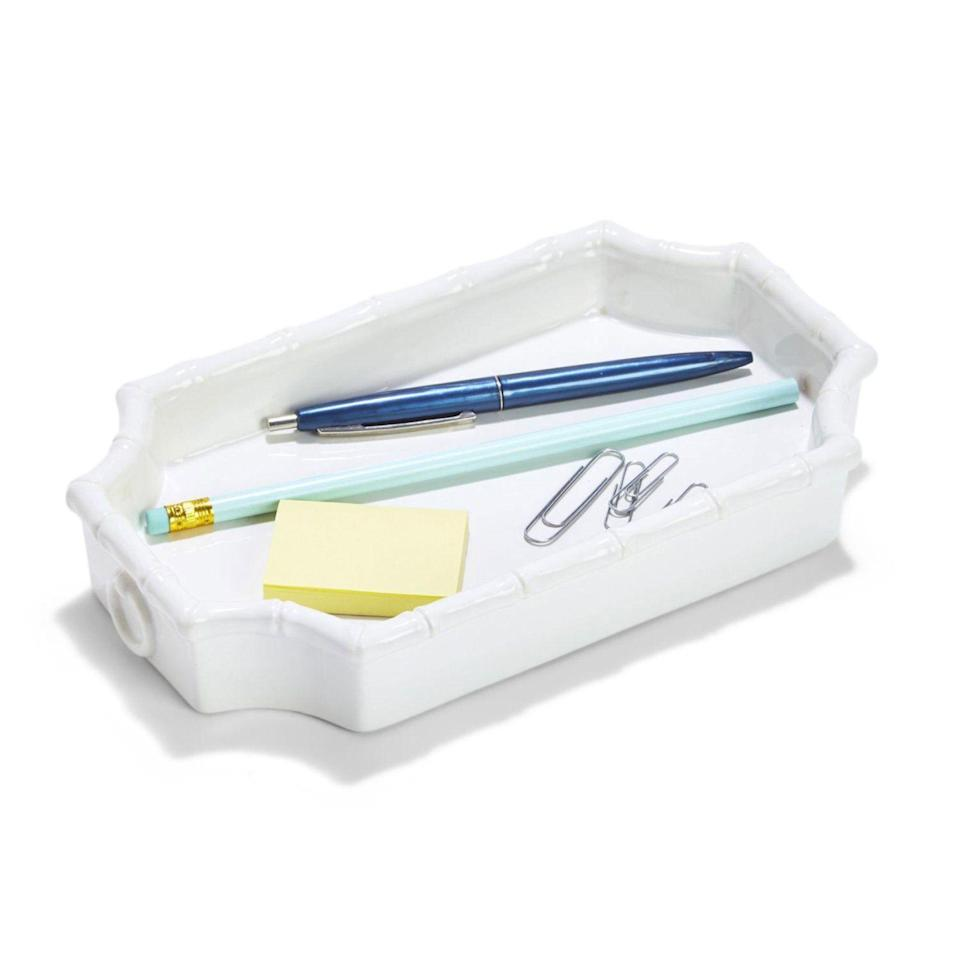 """<p>shopsocietysocial.com</p><p><strong>$29.95</strong></p><p><a href=""""https://www.shopsocietysocial.com/collections/desk-accessories/products/faux-bamboo-t-fretwork-tray"""" rel=""""nofollow noopener"""" target=""""_blank"""" data-ylk=""""slk:Shop Now"""" class=""""link rapid-noclick-resp"""">Shop Now</a></p>"""