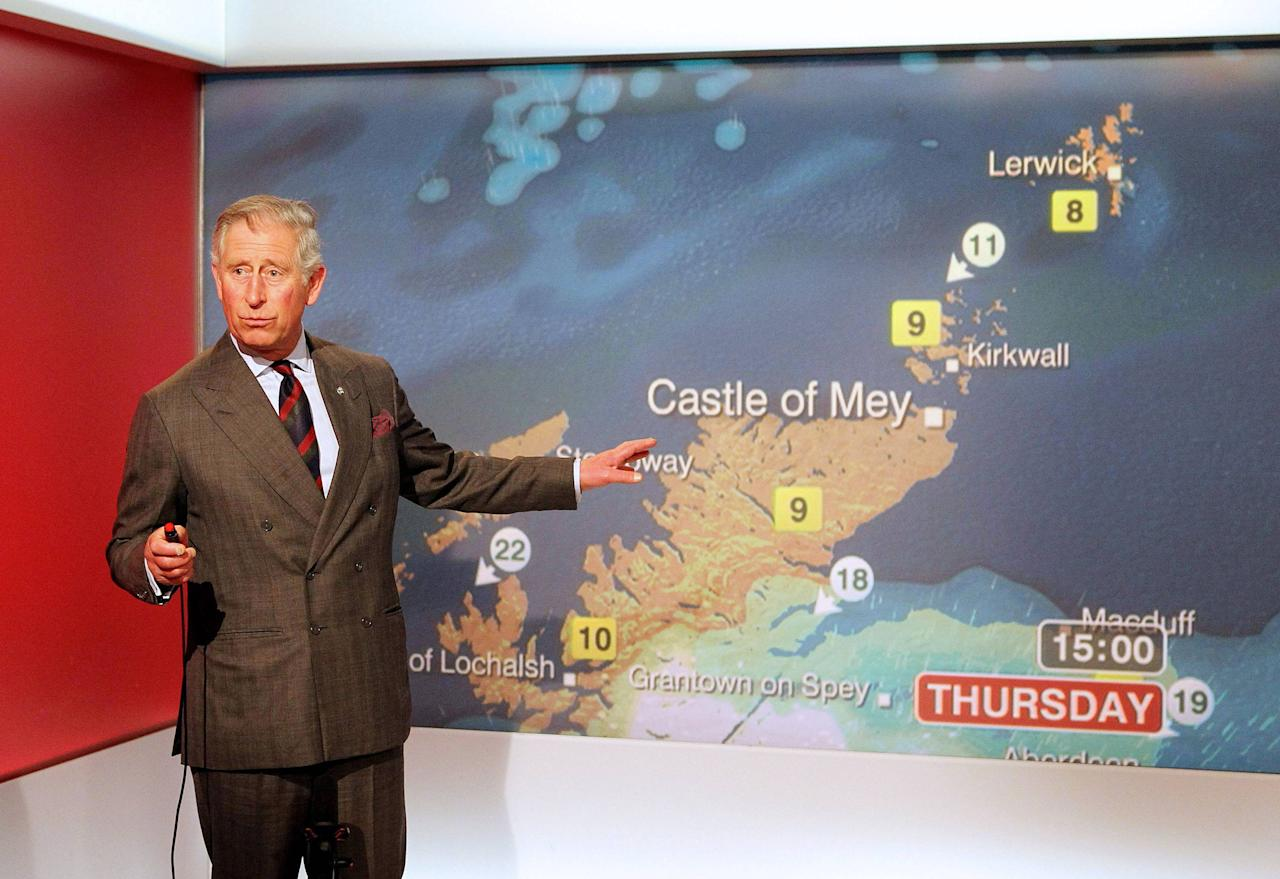 Prince Charles, the Prince of Wales, reads the weather in the Six O'Clock studio whilst on a tour of  the BBC Scotland Headquarters in Glasgow, where he met staff to celebrate sixty years of BBC Scotland Television. Glasgow, Scotland - 10.05.12 **NO UK SALES FOR 28 DAYS**  **Available for publication in the UK & USA only. Not for publication in the rest of the world** Mandatory Credit: WENN.com