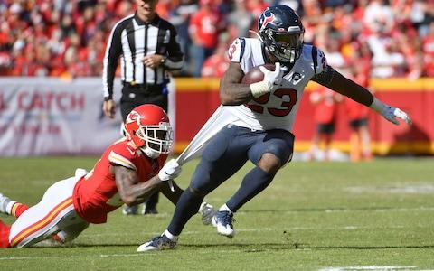 Houston Texans running back Carlos Hyde (23) runs the ball as Kansas City Chiefs defensive back Bashaud Breeland (21) attempts the tackle during the second half at Arrowhead Stadium - Credit: USA Today
