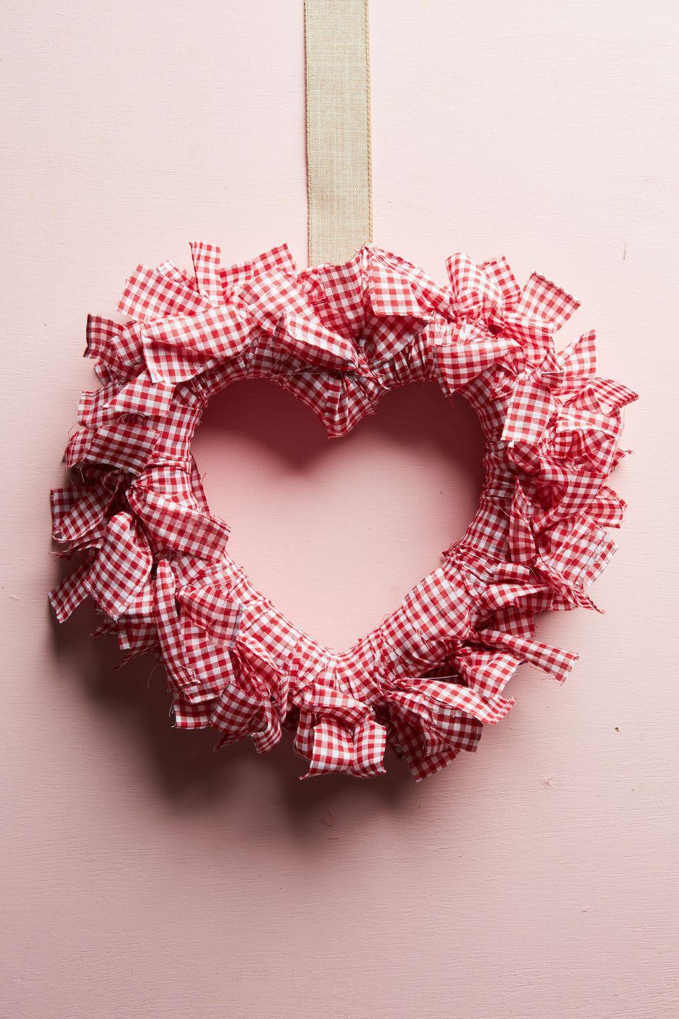 """<p>Hang this cheerful gingham-wrapped wreath on the front door or over a headboard.</p><p><a class=""""link rapid-noclick-resp"""" href=""""https://www.amazon.com/Richland-Textiles-Width-Gingham-Fabric/dp/B01D237W8O/ref=sr_1_2?tag=syn-yahoo-20&ascsubtag=%5Bartid%7C10050.g.2971%5Bsrc%7Cyahoo-us"""" rel=""""nofollow noopener"""" target=""""_blank"""" data-ylk=""""slk:SHOP GINGHAM FABRIC"""">SHOP GINGHAM FABRIC</a></p>"""