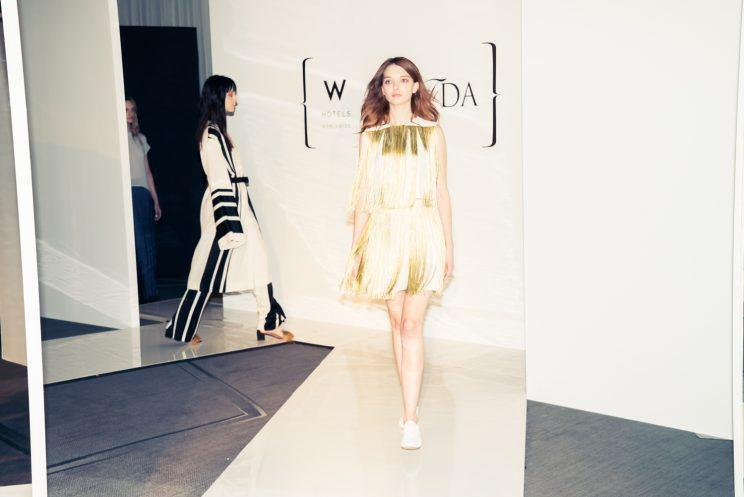 A model walks the runway in Ji Oh's fringed dress at the W/CFDA Showcase in Dallas. (Photo: Courtesy of CFDA + W Hotels)
